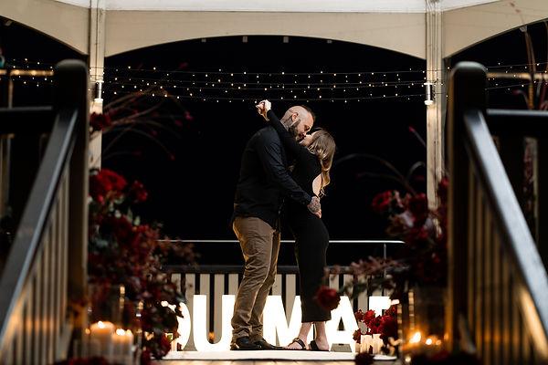Sydney engagement proposal at Observatory Park, couple embracing