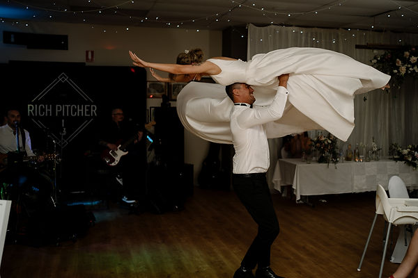 Bride and groom dancing wildly