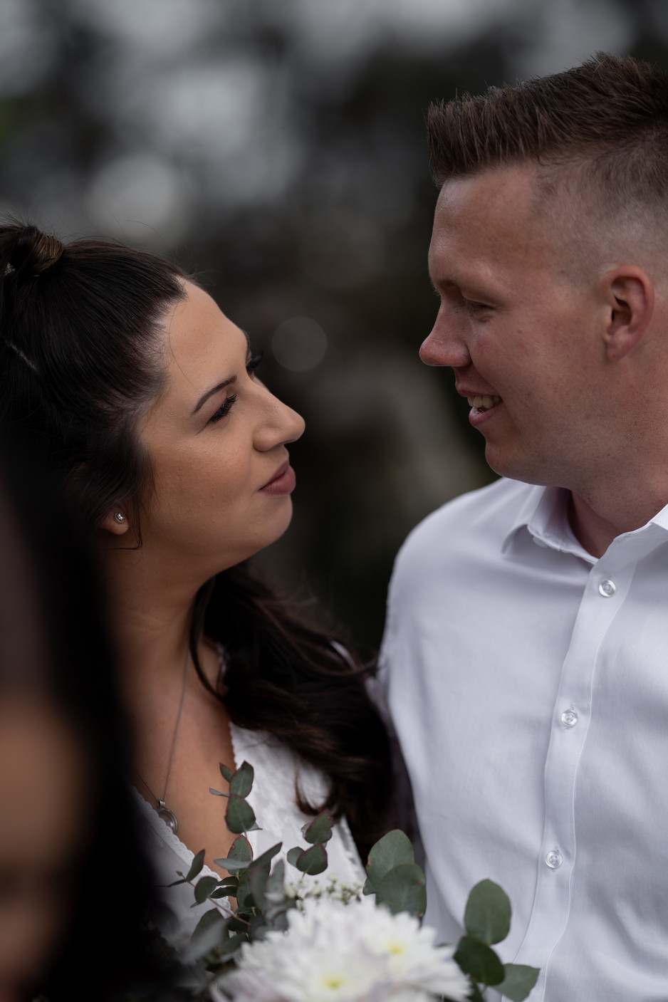 Bride and groom staring at each other