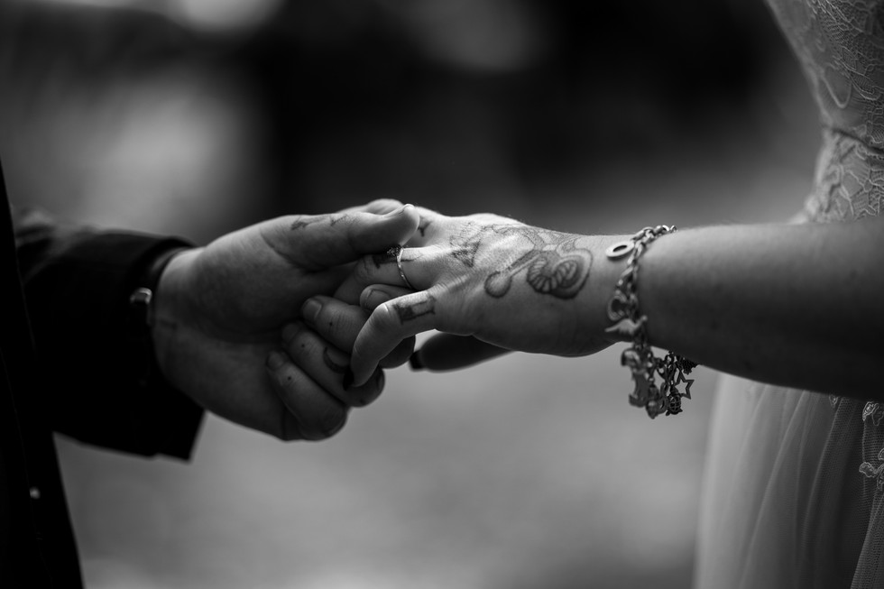 Black and white image of holding hands