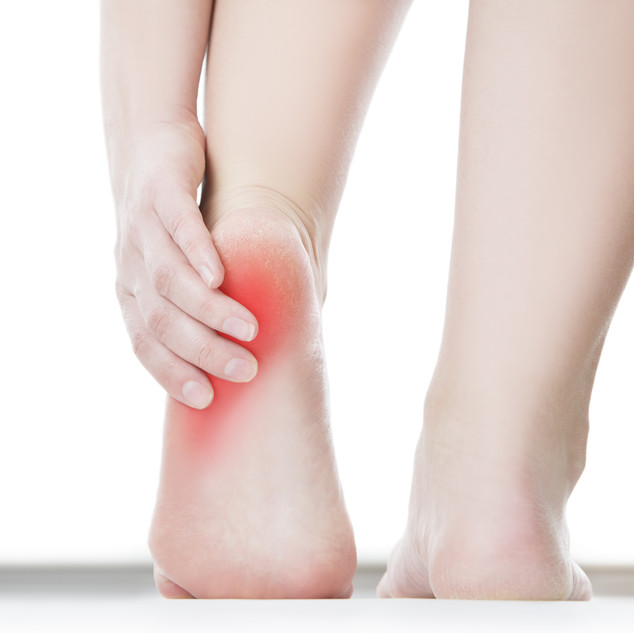 Pain in the foot. Massage of female feet