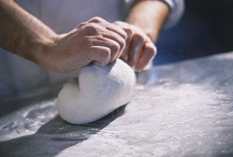 hands-kneading-pizza-dough-kitchen-surfa