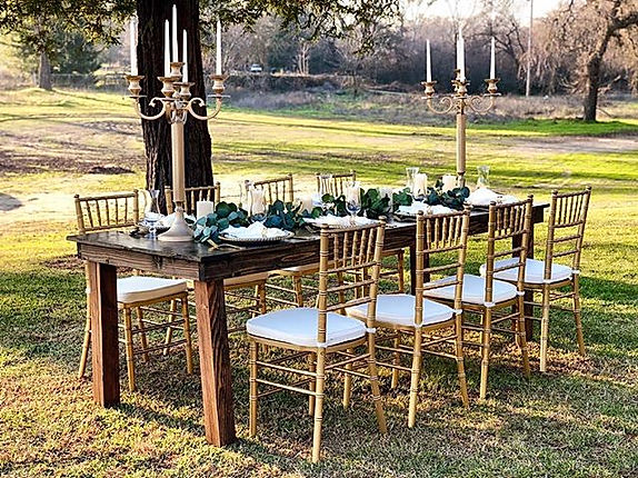 Gold Chiavari Chairs and farm table comb