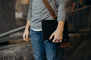Man Holding Laptop