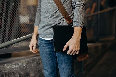 Man Holding Laptop indecent images devices
