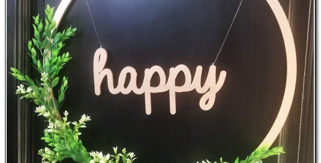 """Happy"" wooden ring wall art"