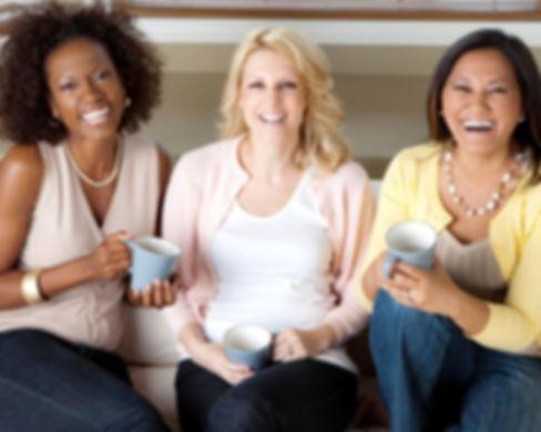 Women having coffee and talking._edited_