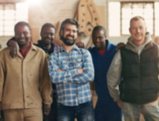 Group of carpenters smiling at the camer