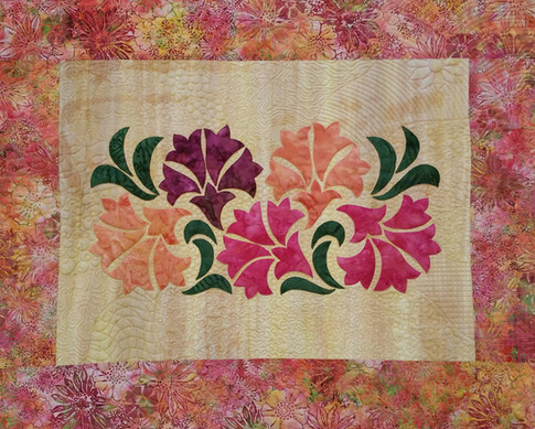 Freehand quilted designs.