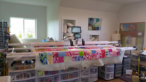 Me, Quilting with both my Handi Quilters at the same time.