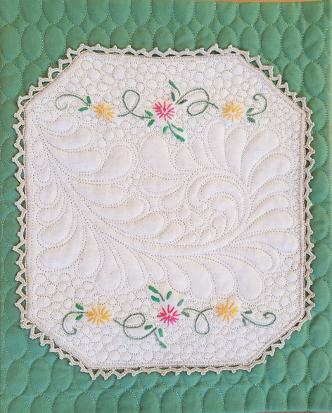 A small Vintage piece, Free hand quilted.
