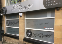 River Lounge: Tray sign with raised lettering.