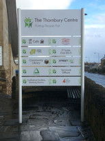 The Thornbury Centre: Slatted sign with vinyl graphics.
