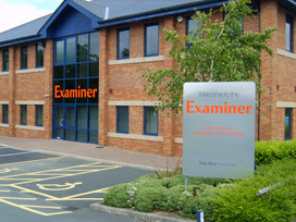Examiner: Entrance sign is aluminium raised letters coloured red. Side sign is stainless steel effect aluminium composite with vinyl lettering.