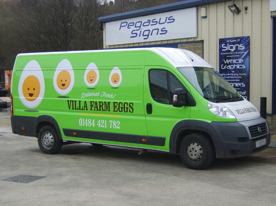 Vehicle wrap applied to sides and rear doors.