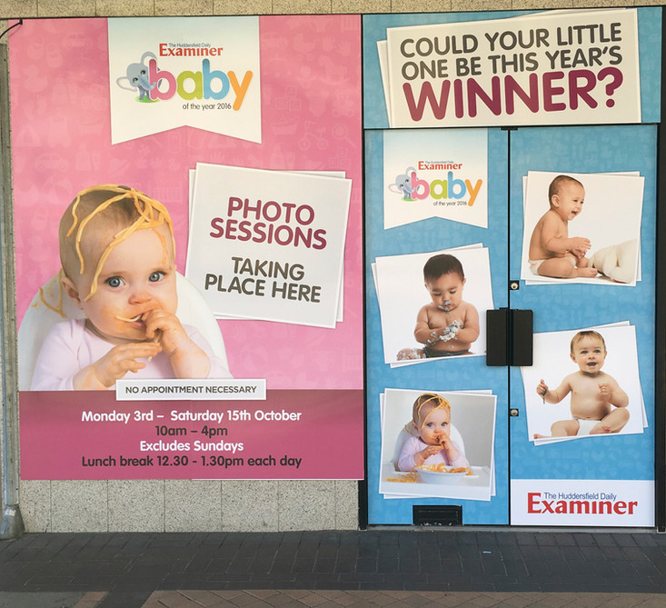 Examiner Baby of the Year Signage
