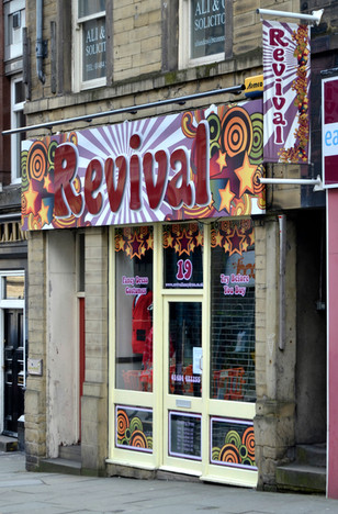 Revival: Vinyl print on a tray sign with raised letters, printed PVC banner and vinyl window graphics.