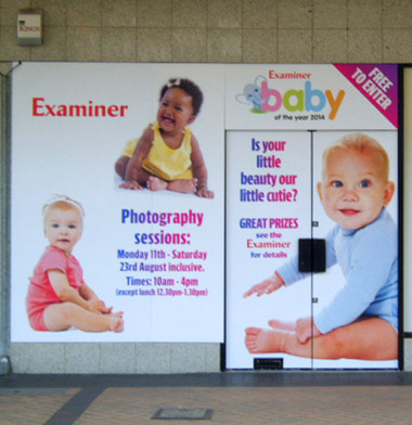 Printed graphics mounted onto fluted board for temporary advertising.