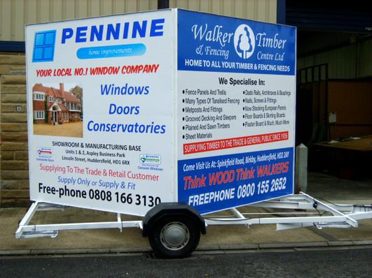 Pennine/Walker: Flat signs with vinyl graphics.