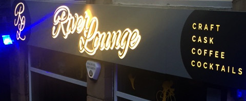 River Lounge: Tray sign with raised letters and back-lit by LED lighting.