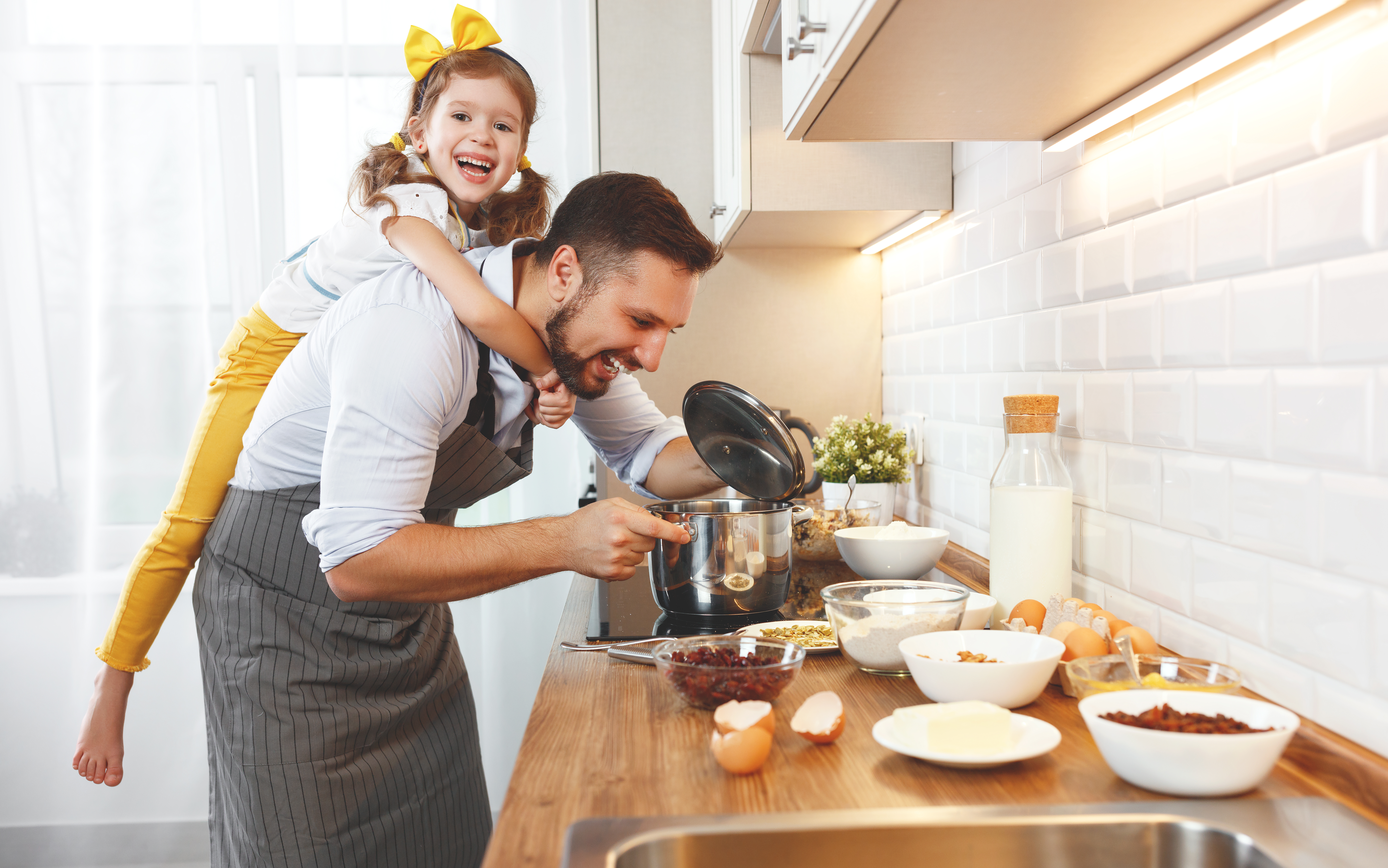 bigstock-Happy-Family-In-Kitchen-Fathe-2