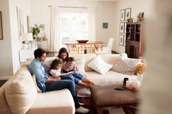 bigstock-Young-Hispanic-family-sitting--