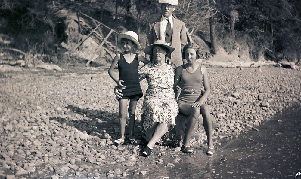 Family on beach.
