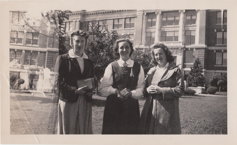 Three women outside a building.