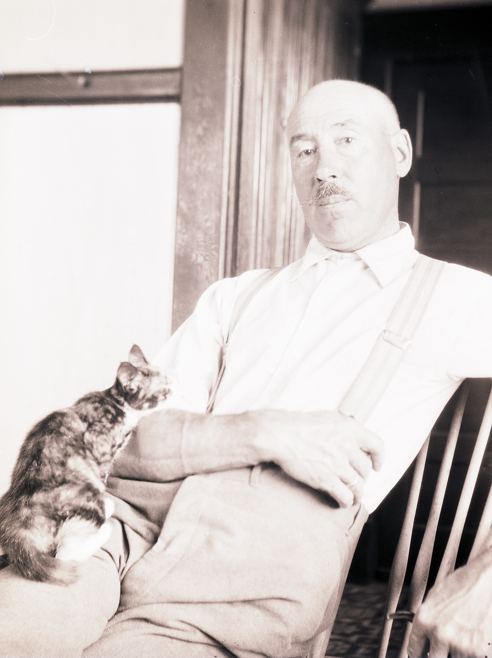 Man with cat on lap.
