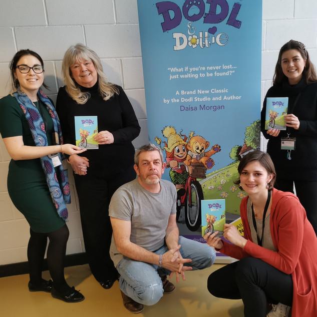 Dodl & Dottie Team with Banner 2020.jpg