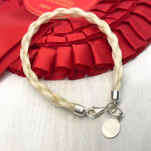 white horse hair bracelet with tag