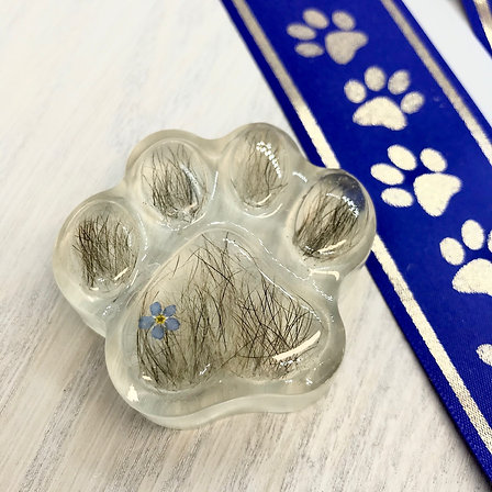 Paw Print containing your Pets Fur or Ashes