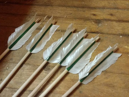 Swan fletched military arrows in progress