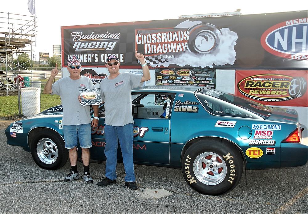 Clint Fields, right, from Vincennes, Indiana, won the Pro Class and Racer Rewards at Crossroads Dragway.