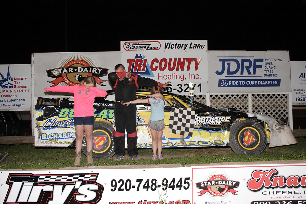 GOLD STAR RACING PRODUCTS GRAND NATIONAL  Jeff Richards strikes 'the pose' with his girls following his second feature win of the season Friday night at the Oshkosh SpeedZone
