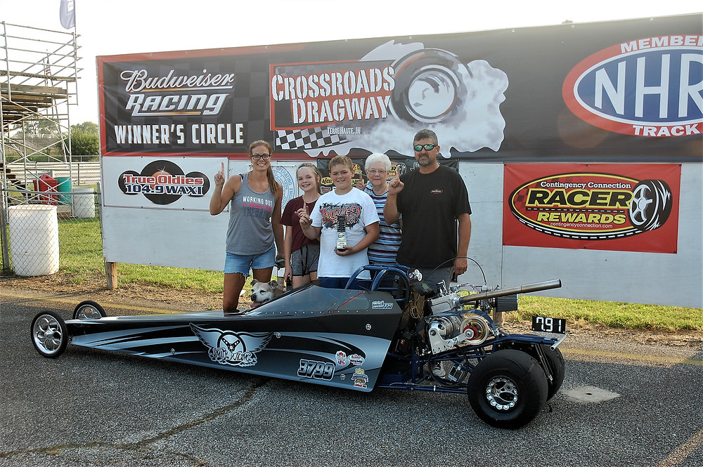 Michael Smith, center, from Rosedale, Indiana, won Plumbers & Steamfitters Local 157 Junior Dragster Class and Racer Rewards at Crossroads Dragway.
