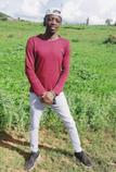 Shema Chris at his Nyagatare farm land