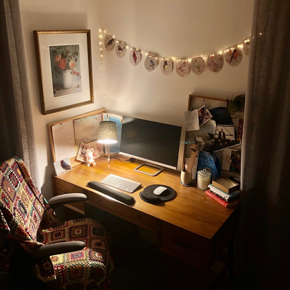 My writing space is a desk in a corner of the spare bedroom at home. The gorgeous Australian bird bunting was a gift from my husband a few years ago, as was the colourful crotchet blanket on the chair. He had very good taste. I have a few meaningful notes and photos dotted around nearby, as well as Henry Miller's '11 Commandments for Writing' and Pixar's 'Rules of Storytelling' printed out and within easy reach, for those sticky moments. I'd like to say I work here all the time, but to be honest, I often find myself drifting back to the kitchen table. For some reason I'm just comfortable writing there, at the heart of the home.