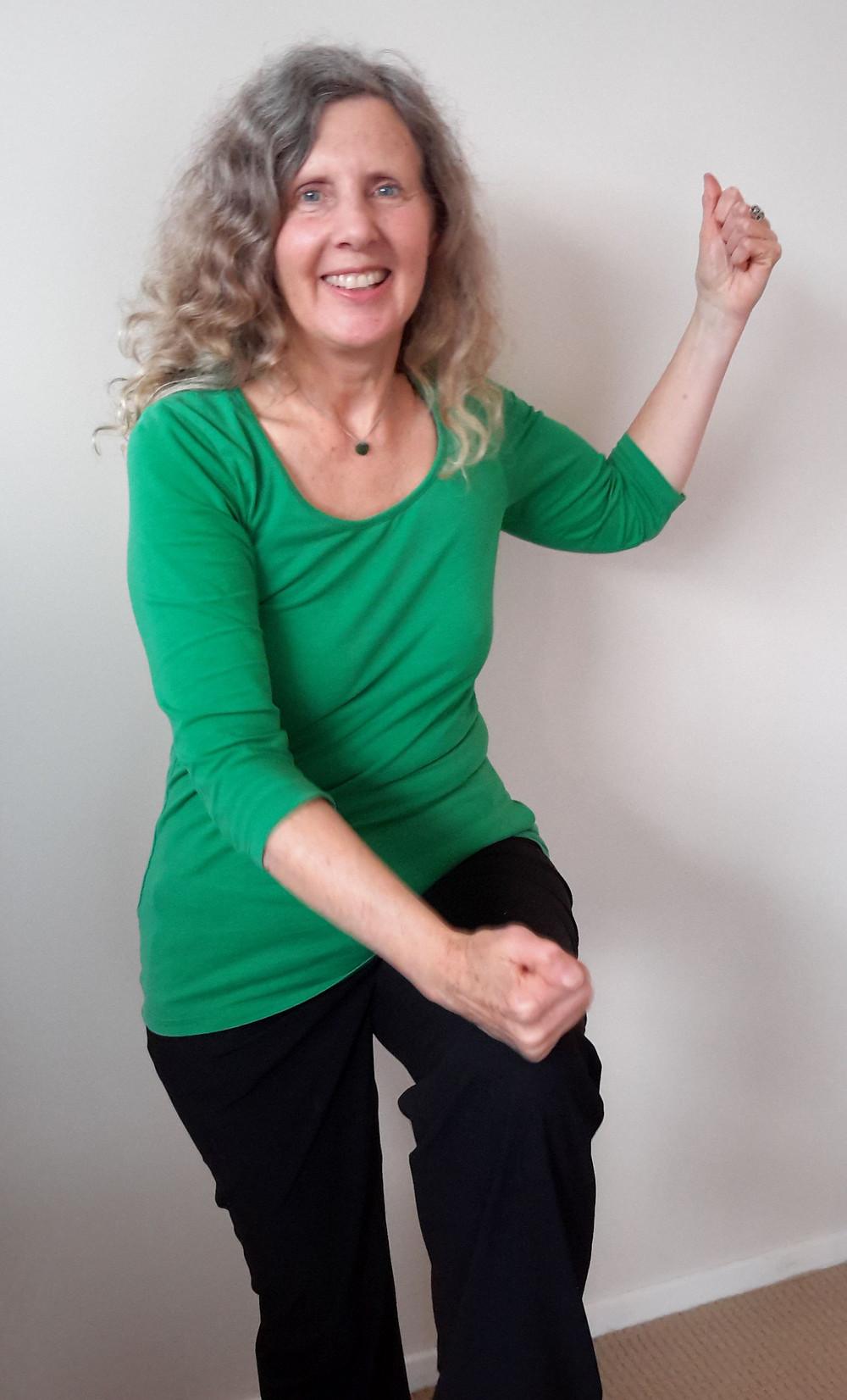 Glenys Earle doing energy medicine Cross Crawl to enhance energy