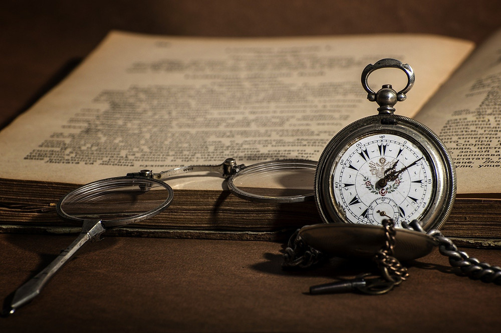 Open book with stop watch for Akashic records reading