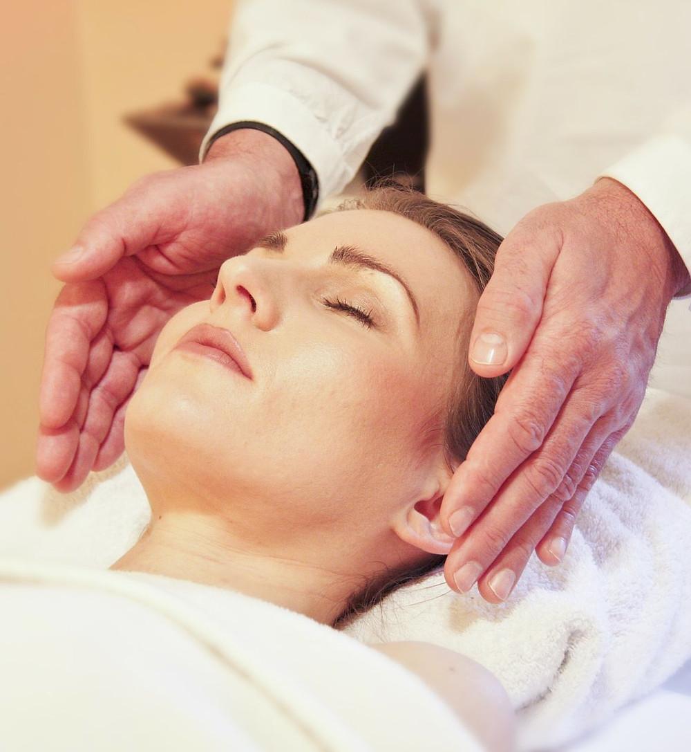 Demonstrating Reiki healing