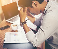 Man at desk feeling tired, energy healing for tiredness, energy healing for insomnia, relief from constant tiredness, relief from insomnia