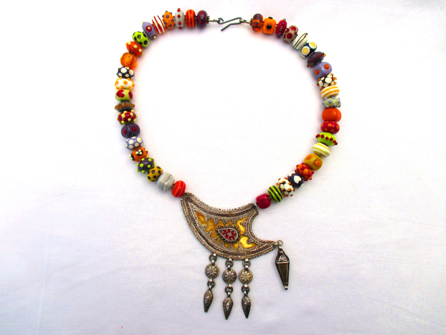 Flameworked beads with found piece