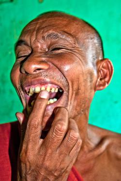 Monk Showing Teeth, near Yangon 2009