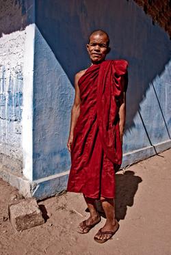 Monk against Blue Wall, Monyuwa, Myanmar 2007