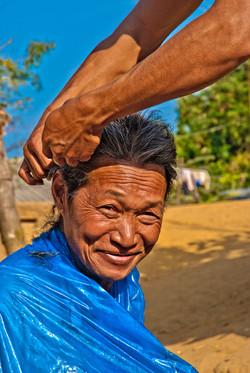 Man Getting a Haircut, near Kyaing Taung, Myanmar 2008