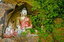 Carved Buddhas, Akauk Taung (Tax Mountain), along the Ayeyarwady River north of Pyay, Myanmar 2008-2