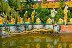 Pool with Naga and Buddhas, Chaung Wa Pagoda, Yangon 2008