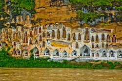 Carved Buddhas, Akauk Taung (Tax Mountain), along the Ayeyarwady River north of Pyay, Myanmar 2008