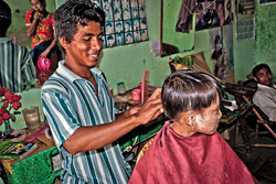 Girl Getting a Haircut, Naung Shwe, Myanmar 2007